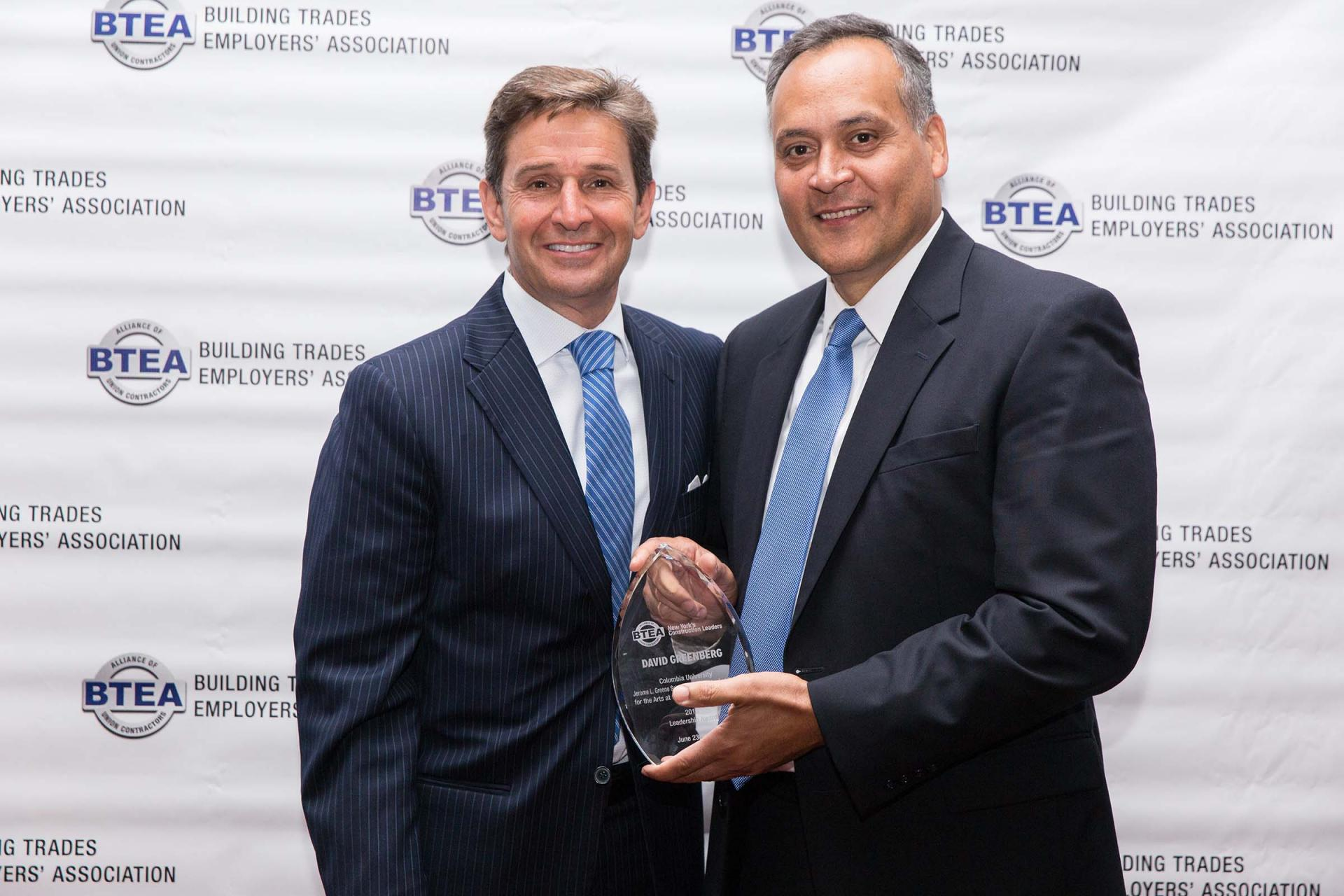 Marcelo Velez, vice president of Columbia's Manhattanville Development Group, receiving the BTEA Leadership Award on behalf of David M. Greenberg, executive vice president of Columbia University Facilities and Operations, from Ralph Esposito, president of Lendlease US Construction.
