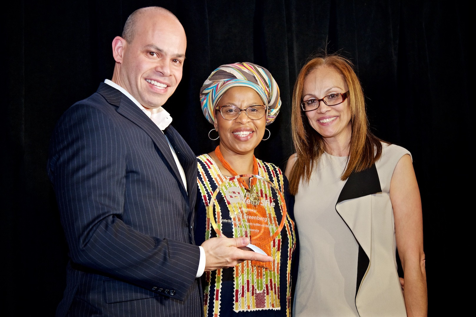 "Annette Lopes (right), AVP for human resources at Columbia University Facilities and Operations, accepting the ""We for She"" award on behalf of David Greenberg from the Women Business Council."