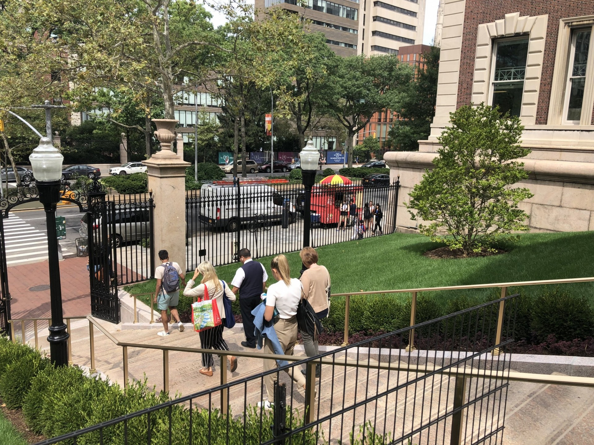 People walking down Earl Hall Gate stairs, which was renovated with new open lawn areas.