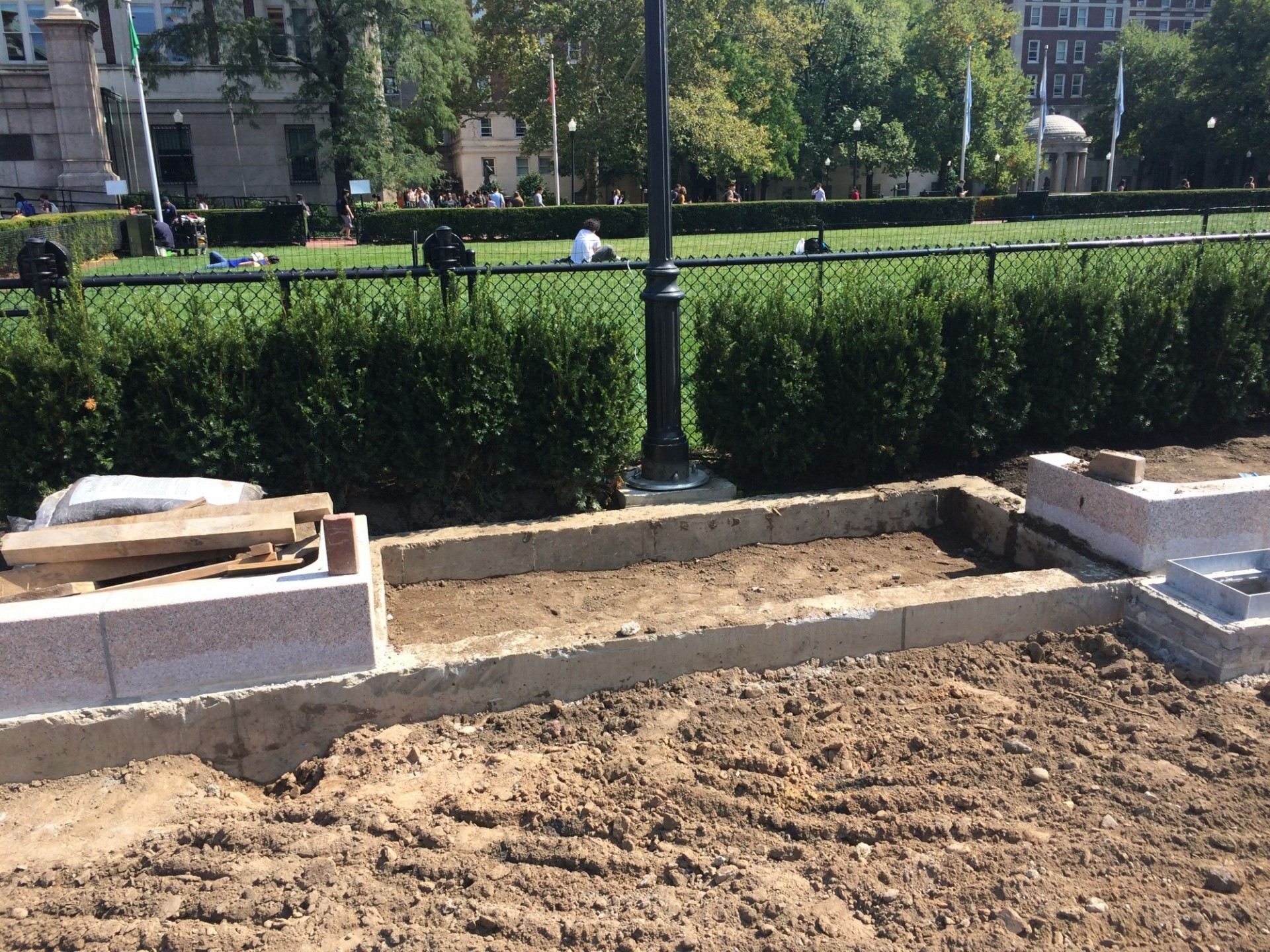 New benches will line the pathways along the perimeter of Butler Lawn. The area for a bench can be seen in this photo in front of the lamppost. (Photo from September 11, 2017)