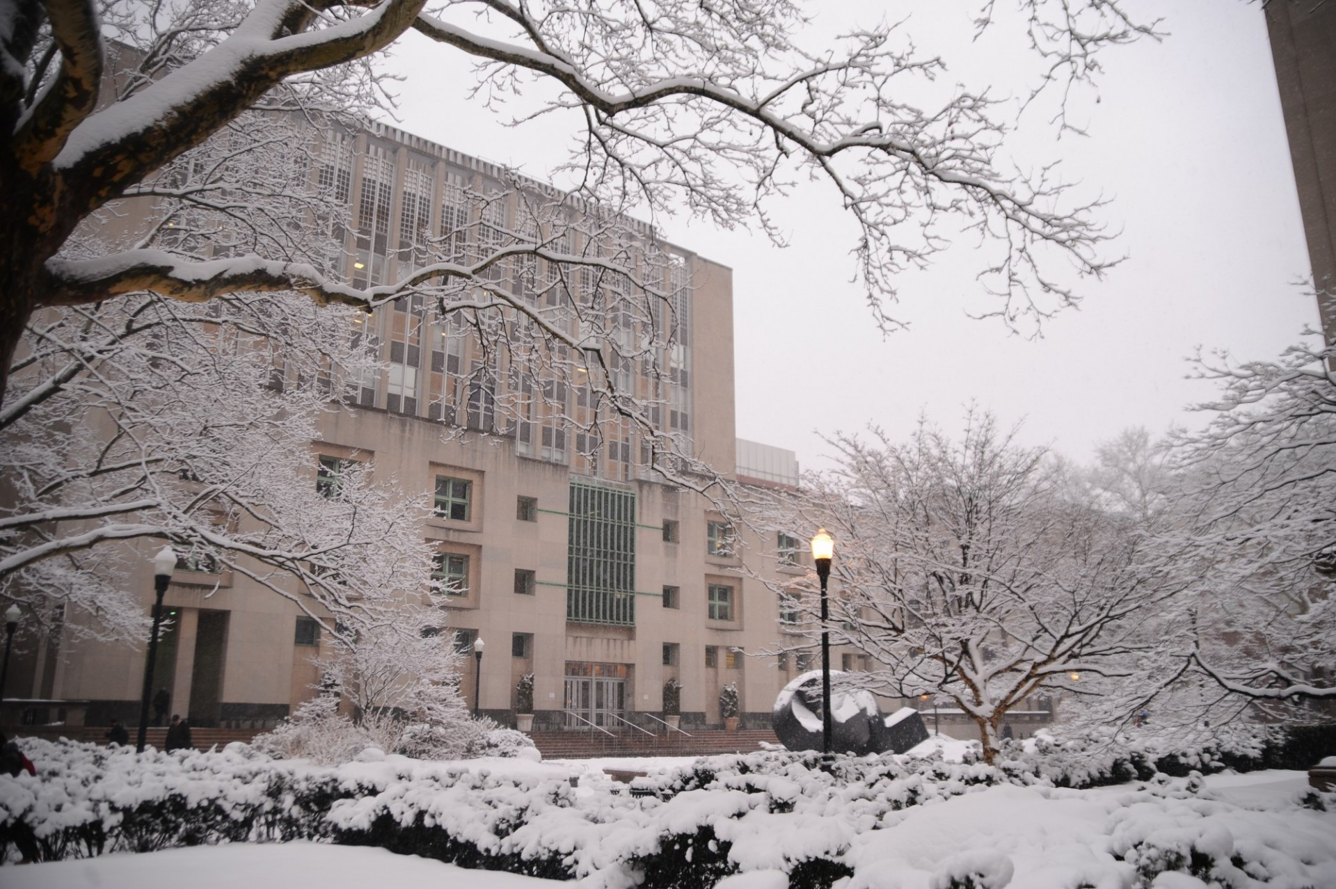 Uris Hall during the winter, surrounded by snow.