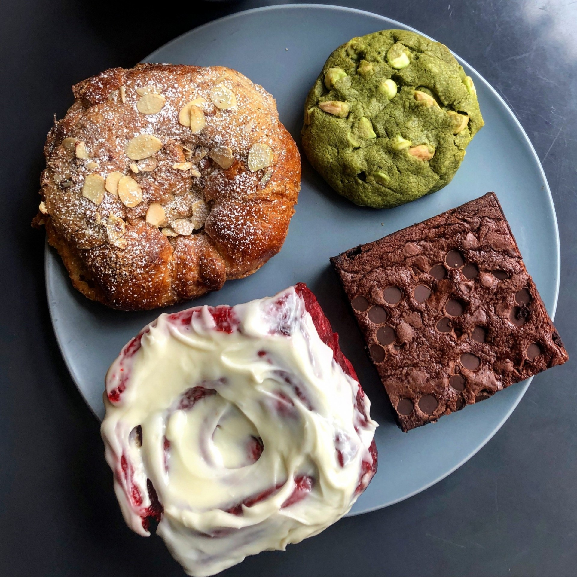 Apple cinnamon french toast croissant, matcha cookie, gluten-free brownie, and red velvet cinnamon roll