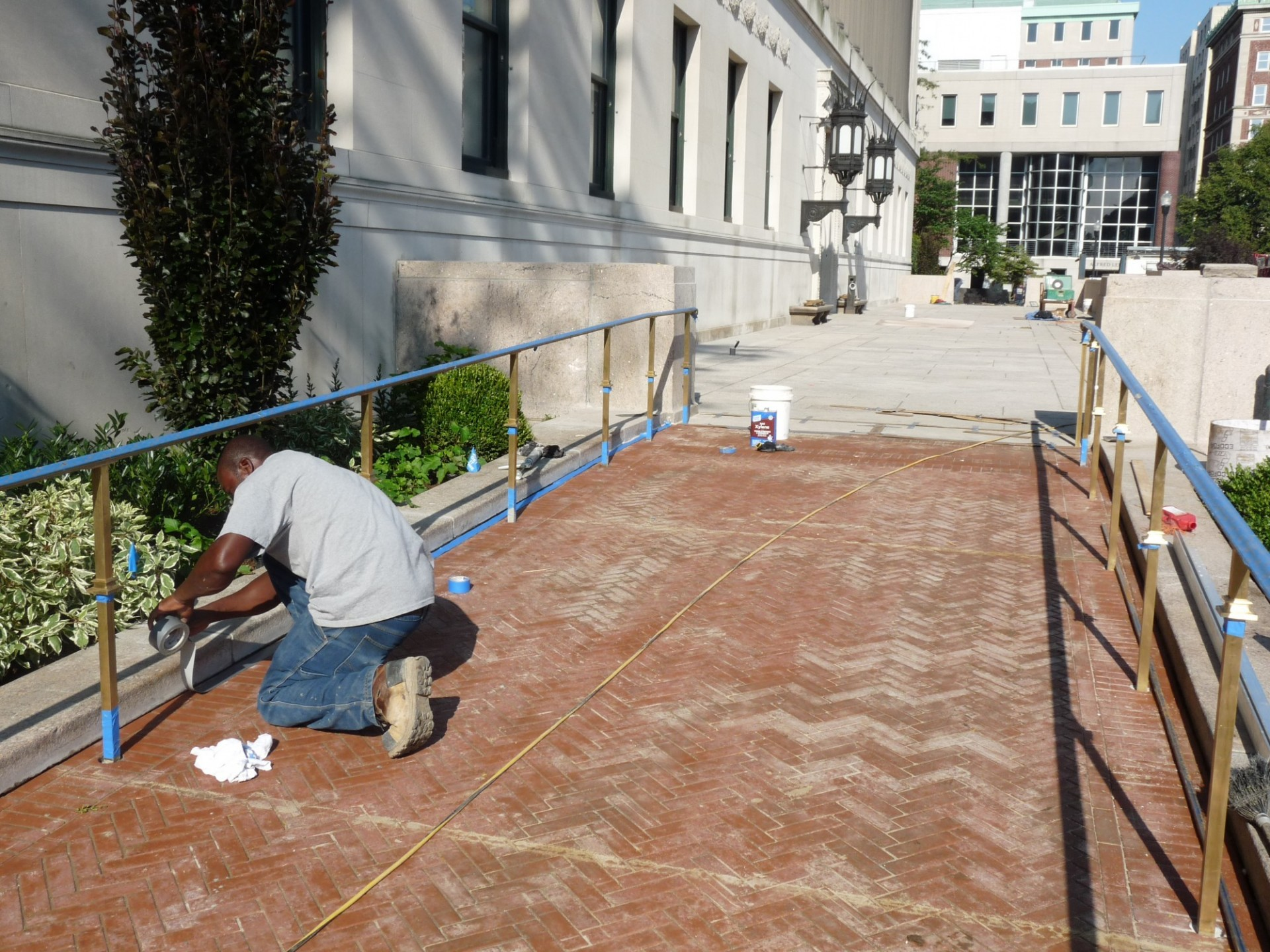 Final preparations being made to the Butler Plaza east walkway in preparation for the library's main entrance to reopen on Sept. 5