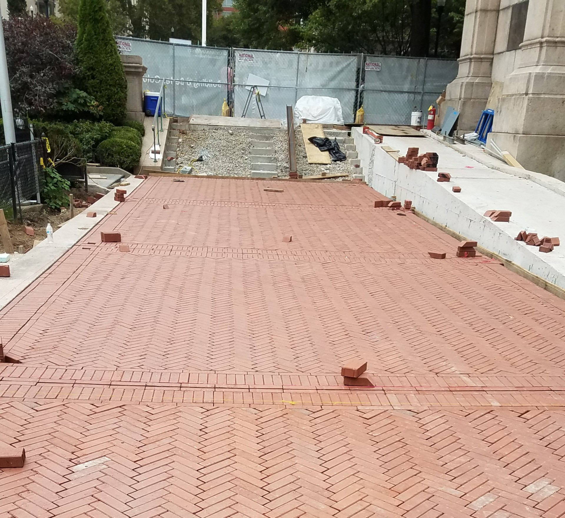 The Lower Campus accessibility ramp project includes the replacement of granite stairs and brick pathway.