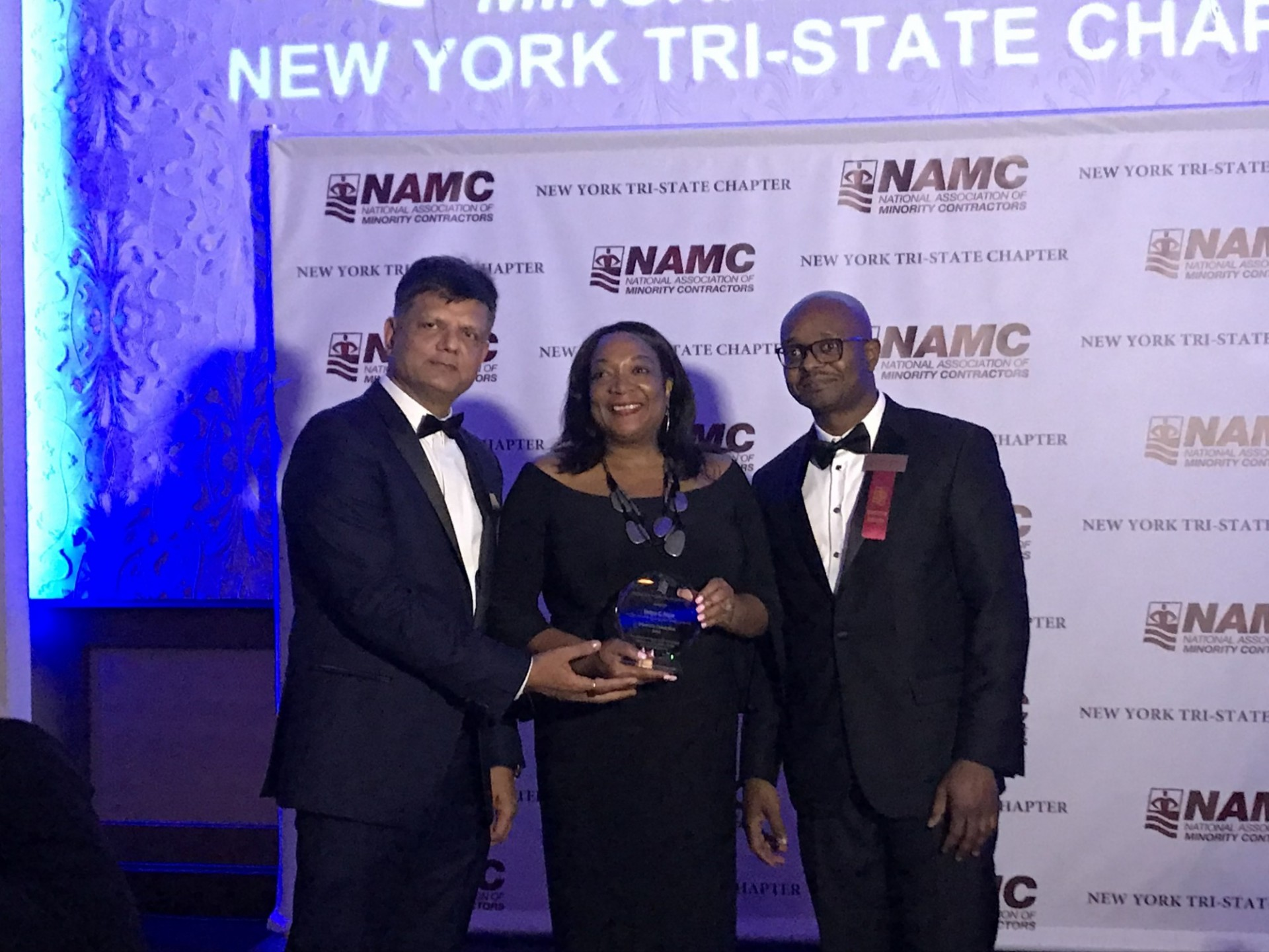 Tanya Pope (center), assistant vice president at Columbia University, receives the New York Tri-State Chapter of the National Association of Minority Contractors 2018 Diversity Champion Award from NAMC-NY President Nayan Parikh (left) and Andrew Fisher, an executive member of the organization.
