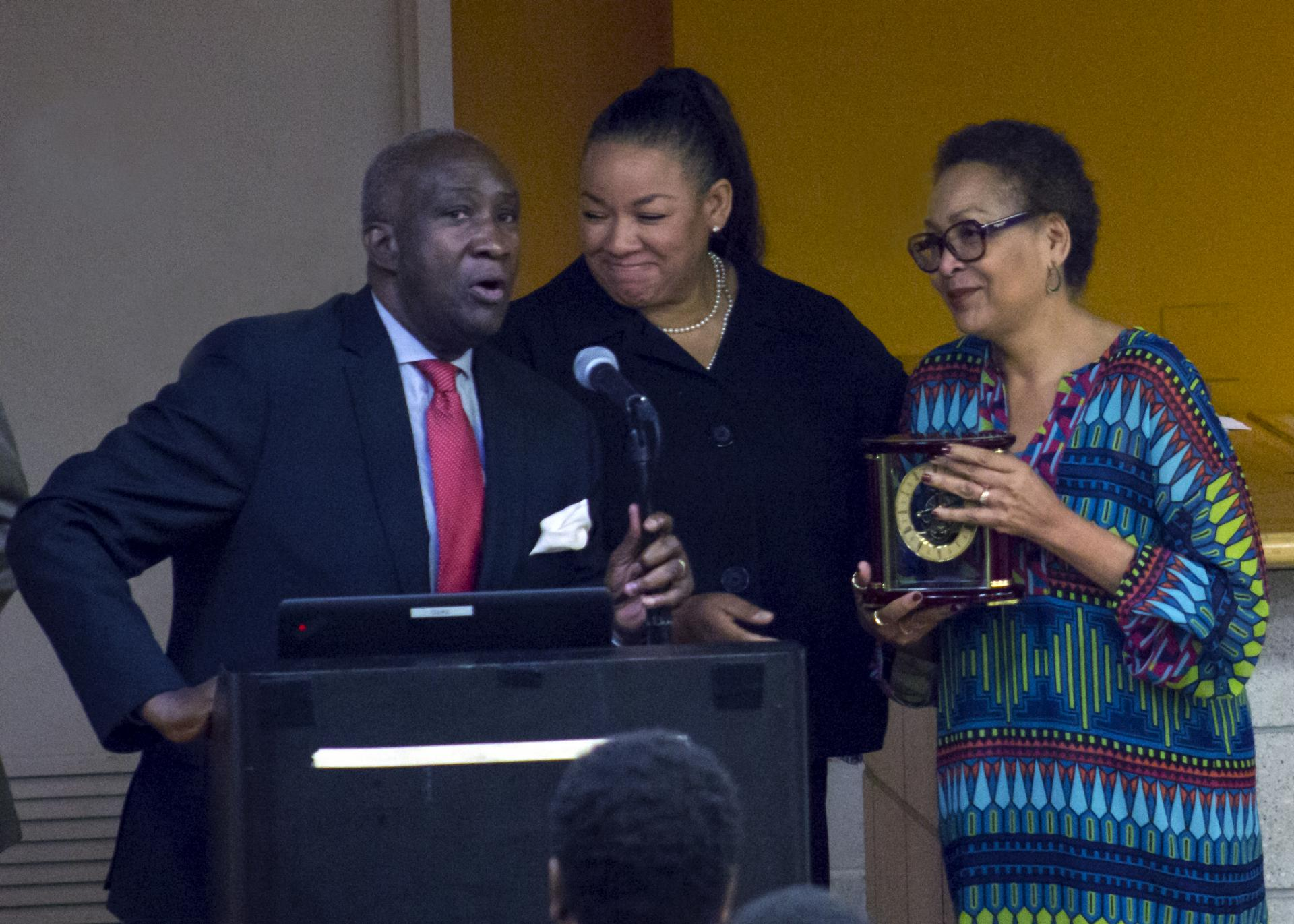 Lloyd Williams, president and CEO of the Greater Harlem Chamber of Commerce, presenting the Outstanding Professional Achievement Award to La-Verna Fountain (right)