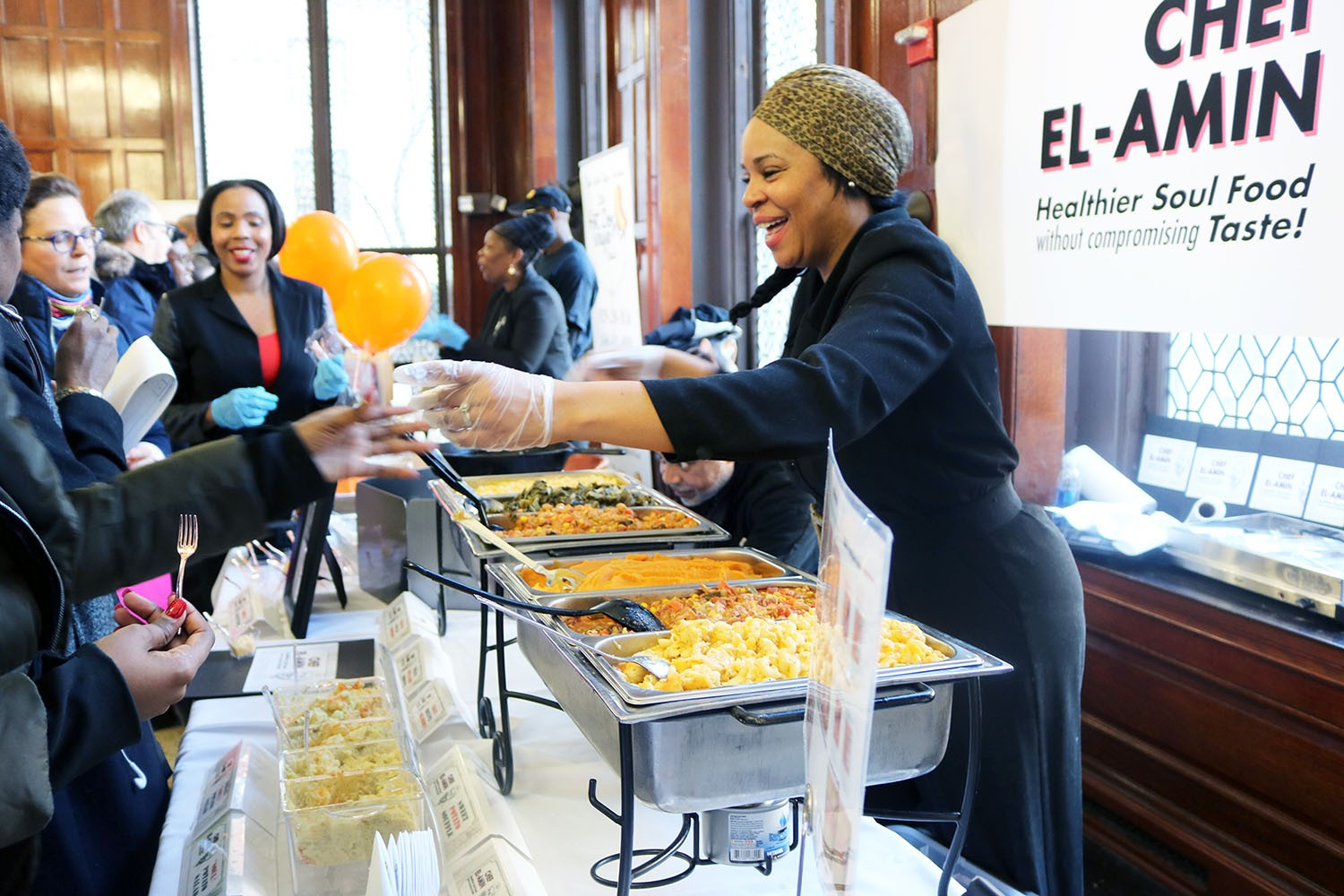 Vendor Chef El-Amin serves samples to participants at the Harlem Buyer Fair in John Jay Dining Hall