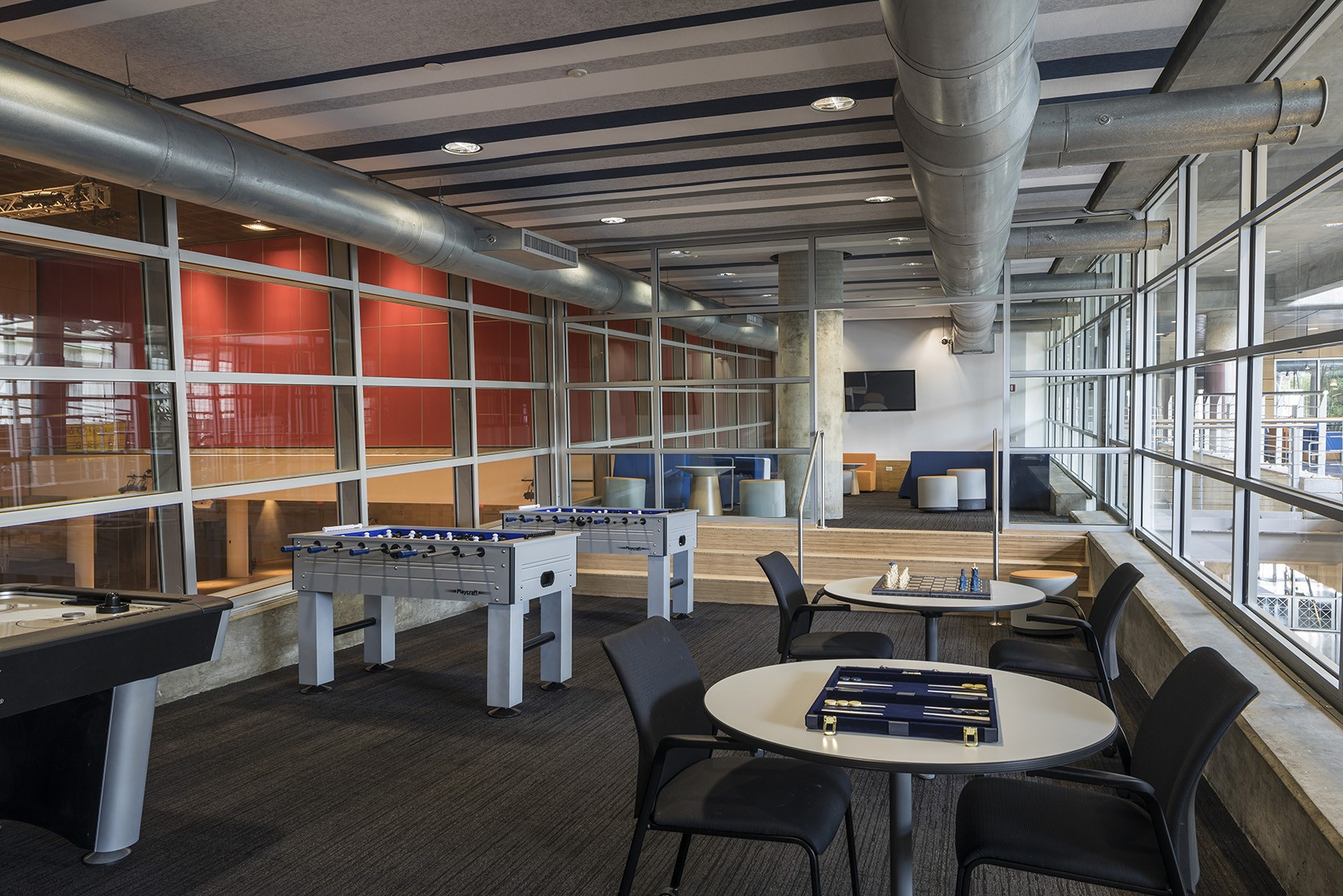 The new Lerner Hall student lounge includes a game room featuring air hockey and foosball tables plus other games like giant Jenga, giant Connect 4, chess, and Legos.  (Photo: Andrew Rugge)