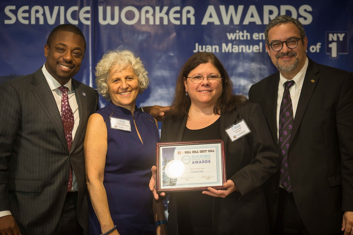 "Loretta Zuk, a building superintendent at Columbia for more than 30 years, receiving the ""Superintendent of the Year"" award at the 11th annual Building Service Worker Awards ceremony."