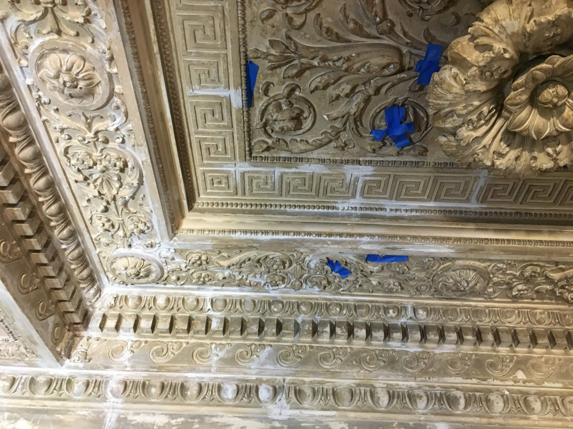 Repairs in progress of the ornate plaster ceiling. The repairs require close attention to detail and careful work to maintain the integrity of the historic ceiling.