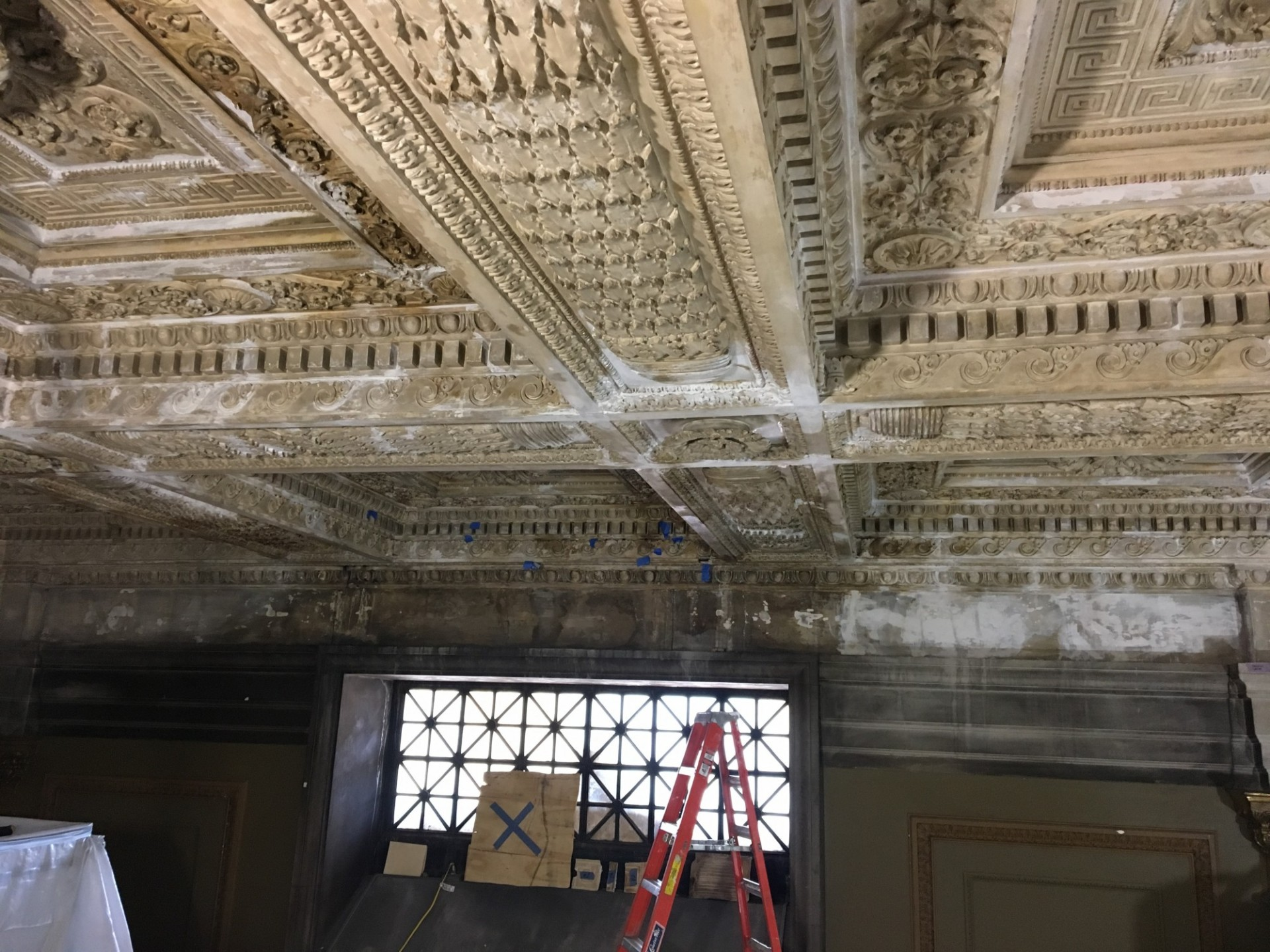 View of a larger section of plaster ceiling repairs.