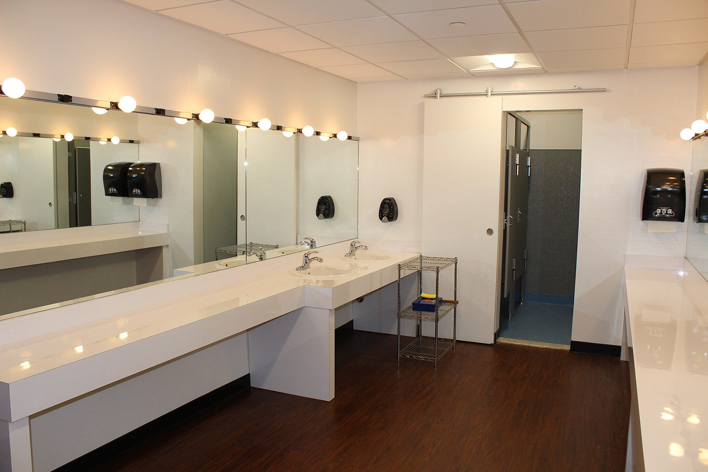 A renovation to the Miller Theatre dressing rooms included dropped ceilings with new tiles and LED light fixtures, an upgraded restroom, and new flooring.