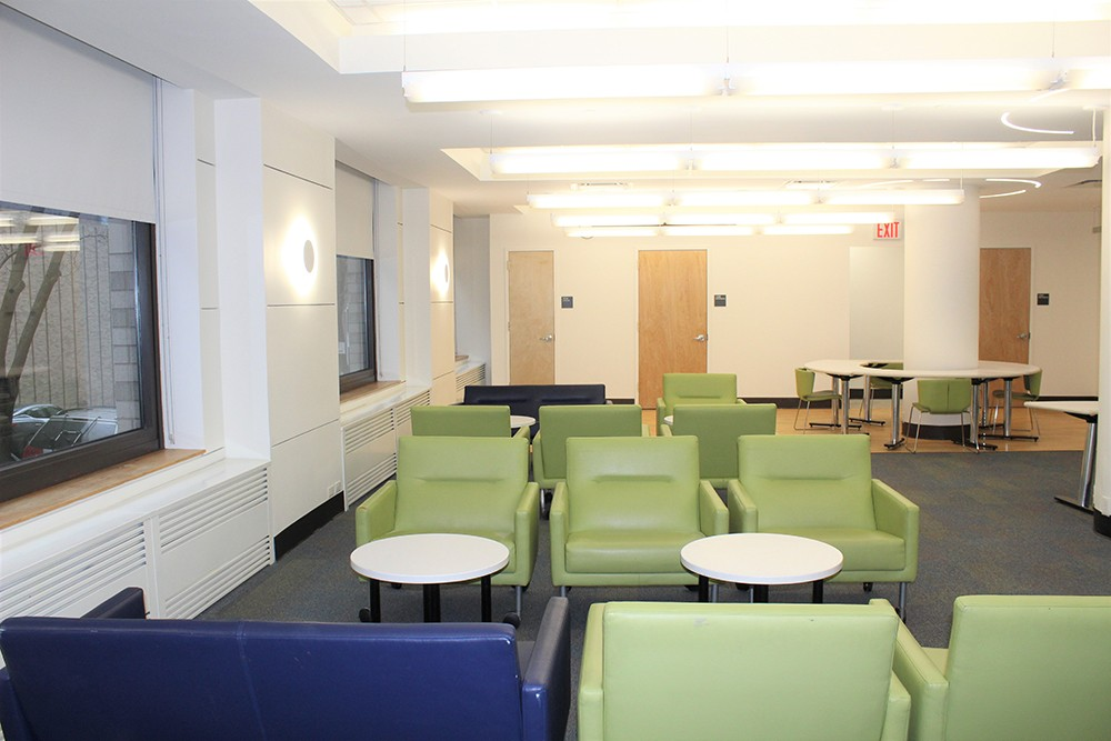 Over winter break, improvements to the Schapiro Hall main lounge included new lighting and painting.