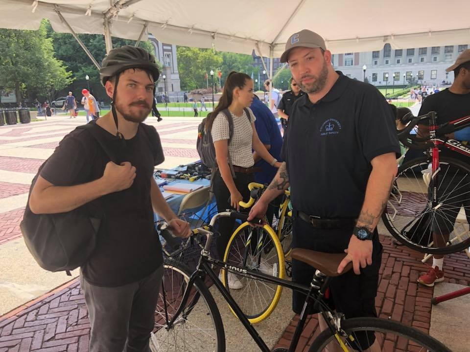 Public Safety Security Officer James Dooner helps a student cyclist