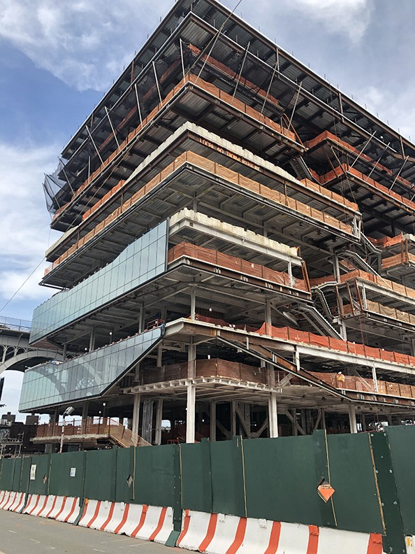 Curtain wall installation is underway at the Henry R. Kravis Building, which topped out over the summer.