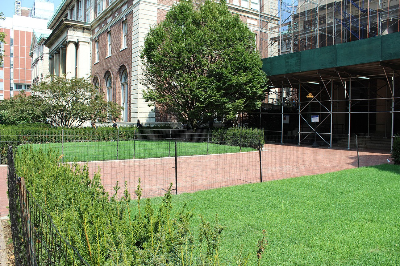 The perimeter shrubs leading up to St. Paul's Chapel were removed to create a more open and welcoming lawn space and building entrance.