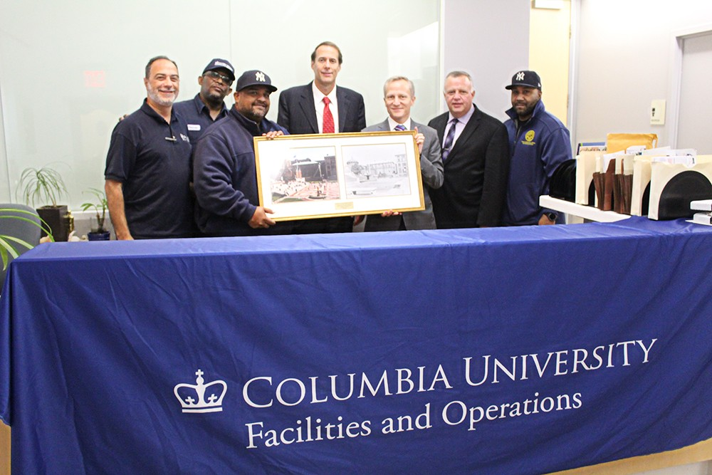 TWU Local 241 leadership received a framed photo and a letter signed from David M. Greenberg, executive vice president for University Facilities and Operations, to celebrate the union's 75th anniversary.