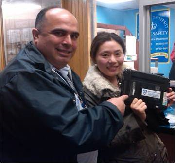 Ricardo Morales, Public Safety's manager of crime prevention programs and Hsiu Lu celebrate the recovery of her laptop.
