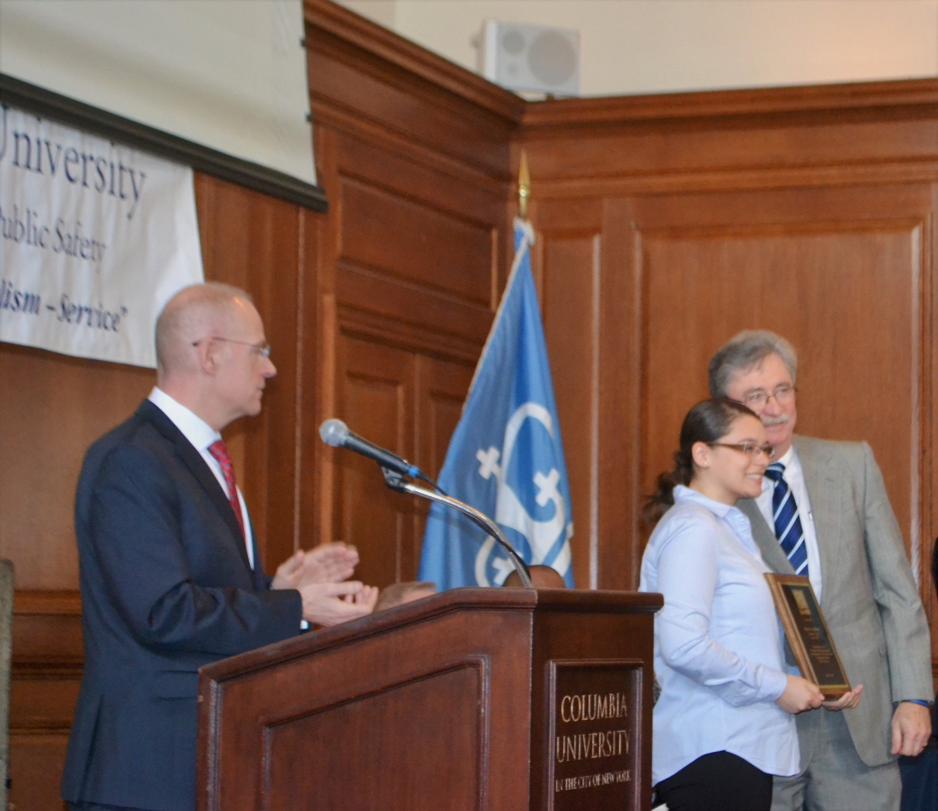 Executive Director Albert Becker presents awards during the ceremony.