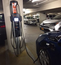 Charging station in use with electric vehicle