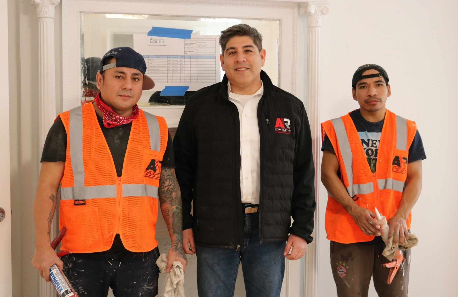 Allan Suarez (middle), chief operations officer at AR Construction, with his team members at a faculty apartment that was recently renovated.