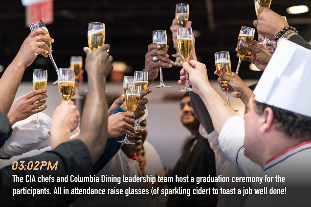 All raise glasses of sparkling cider