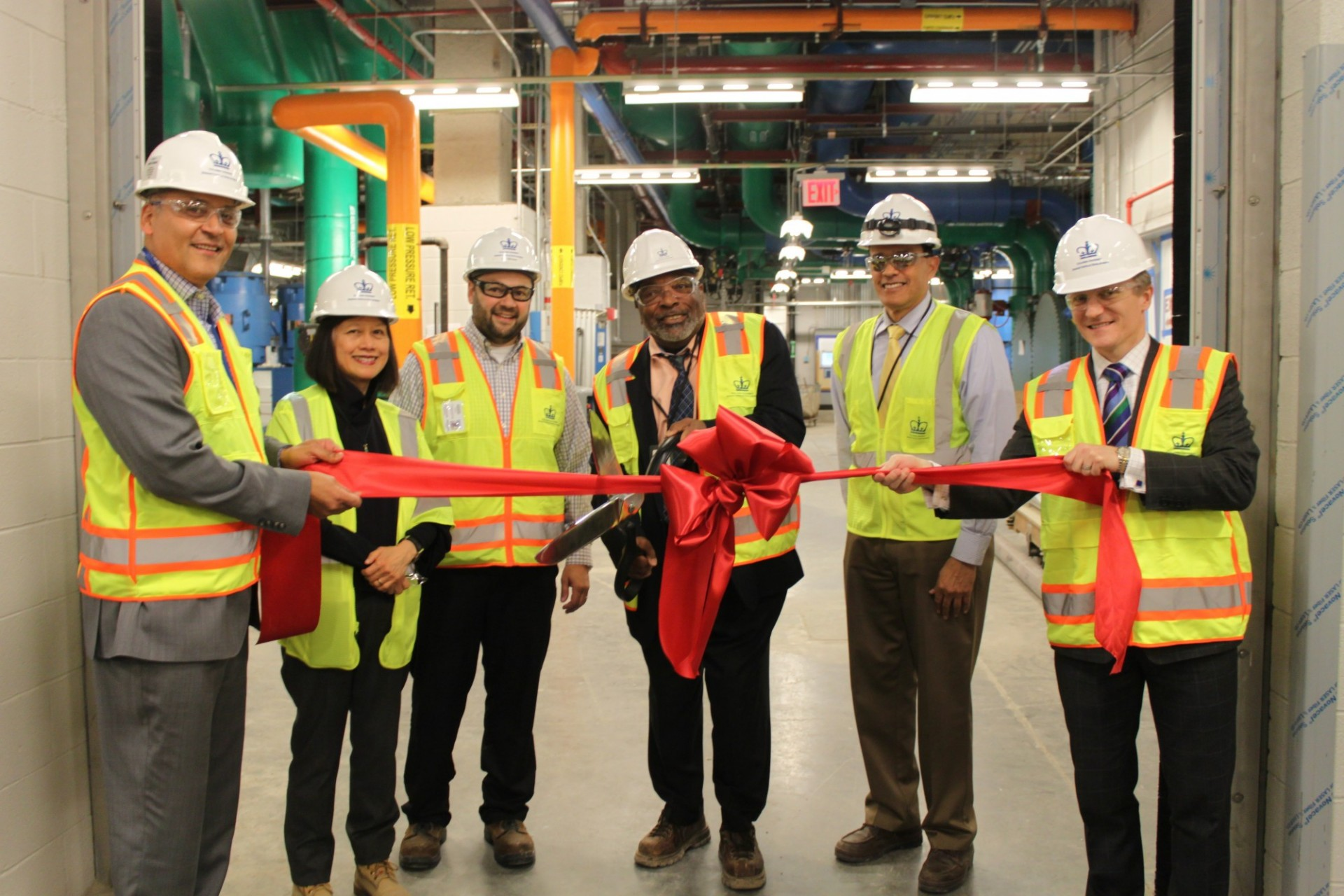 Members of Columbia's Manhattanville team cut a ribbon during an event in May at the Central Energy Plant in recognition of achieving the first temporary certificate of occupancy at the Manhattanville campus. The Central Energy Plant is a below grade facility that provides chilled water, high pressure steam and normal electric power across the Manhattanville campus.