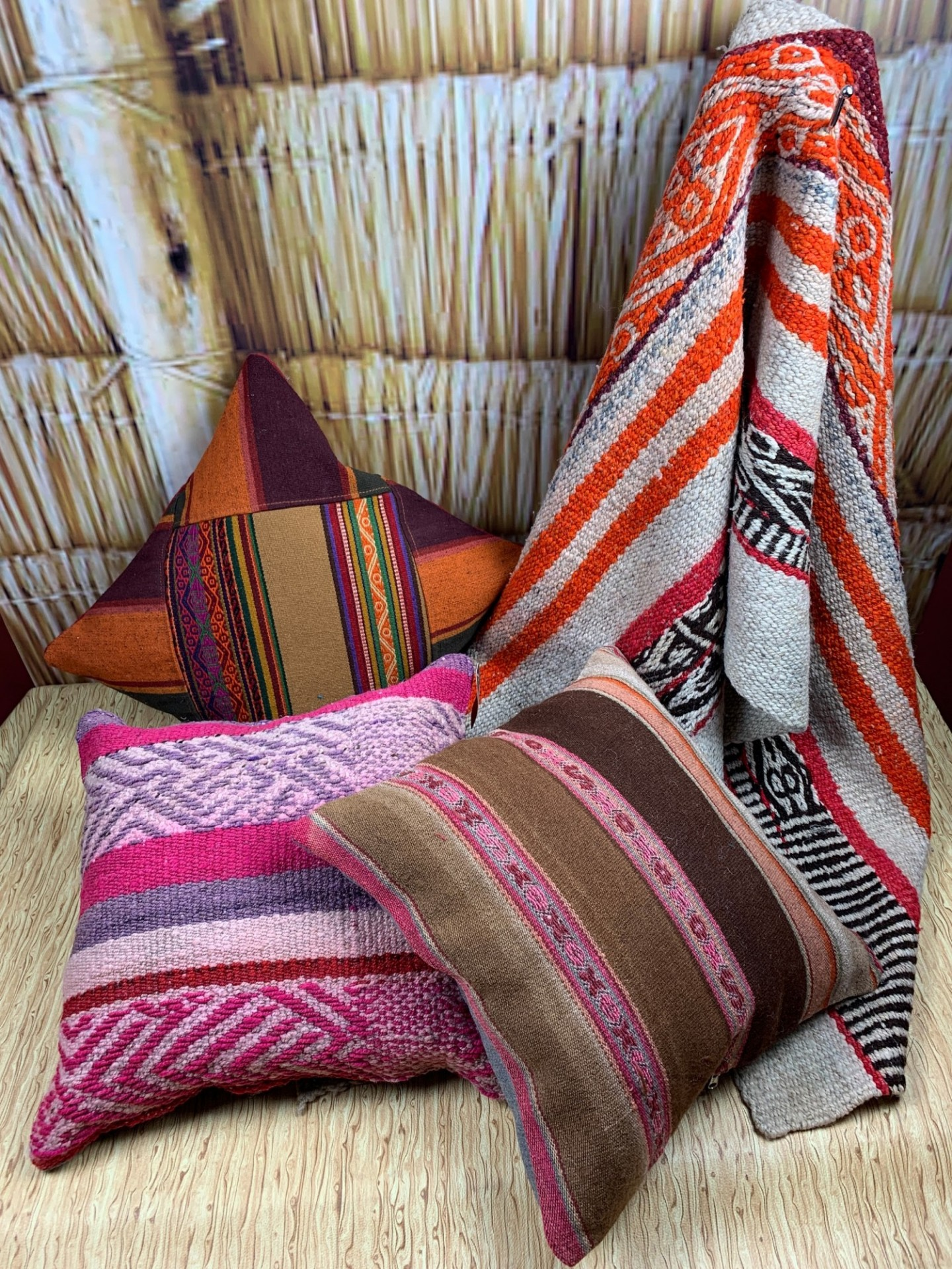 Three pillows and rug handcrafted with several colors mixed throughout